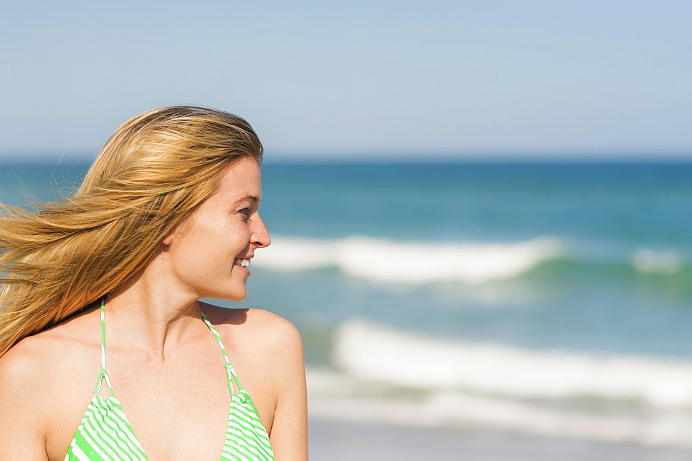 Portrait of young woman on beach, Jupiter, Florida, USA