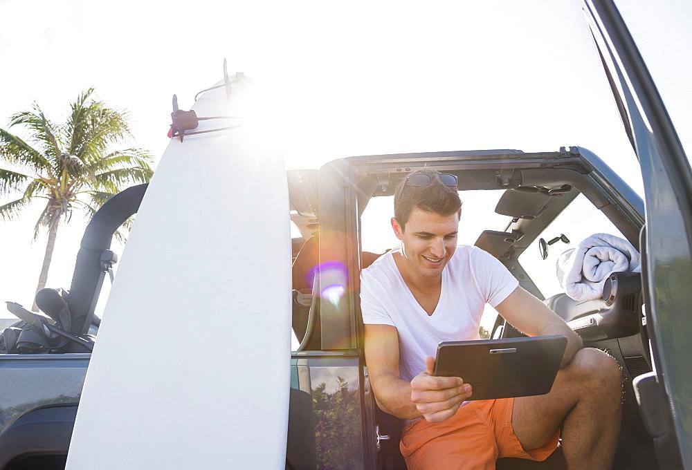 Young man using digital tablet, Jupiter, Florida, USA