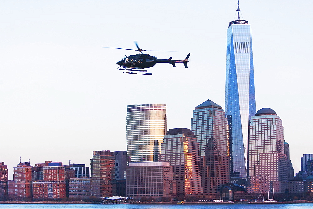 Helicopter flying over city, New York City, USA