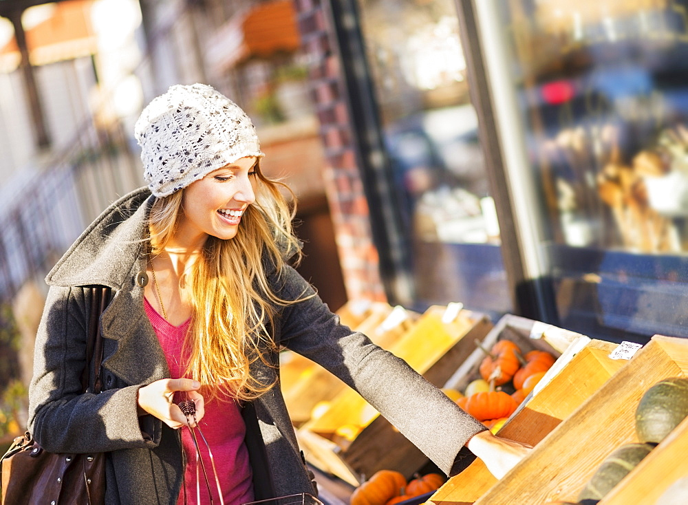 Portrait of woman shopping at market, USA, New York City, Brooklyn, Williamsburg