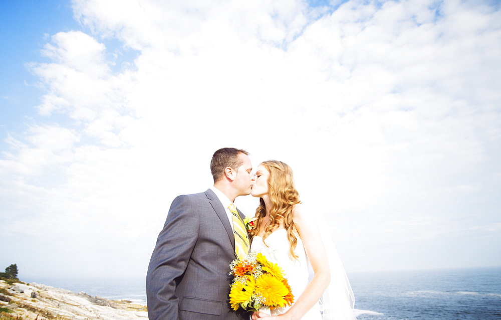 Portrait of married couple kissing, USA, Maine, Bristol