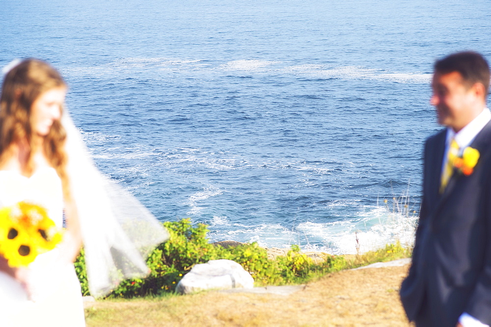 Bride and groom looking at each other, USA, Maine, Bristol