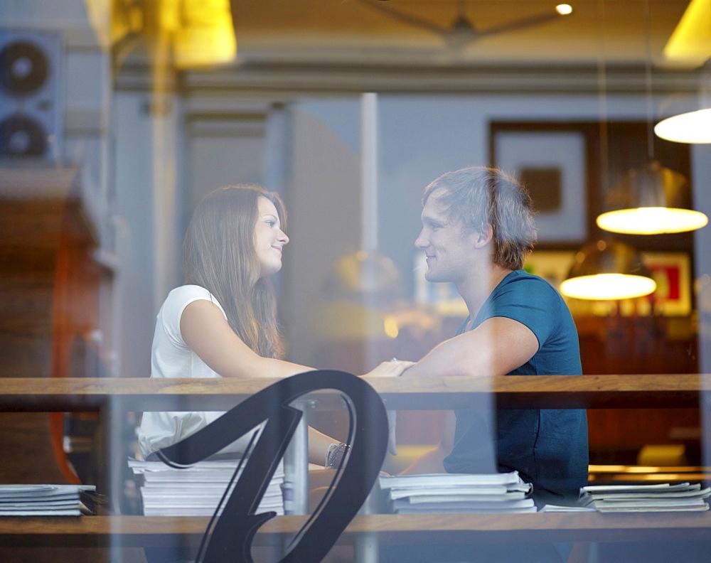 Portrait of couple talking in coffee shop