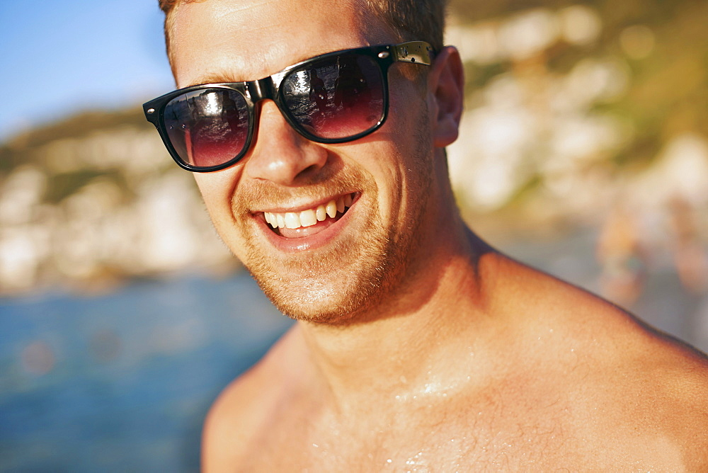 Portrait of young man at beach