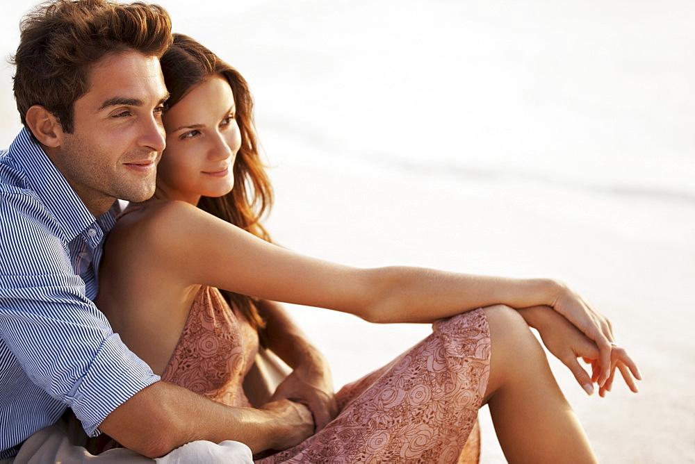 Portrait of couple hugging on beach
