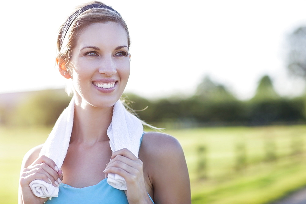 Portrait of smiling woman in fitness clothes