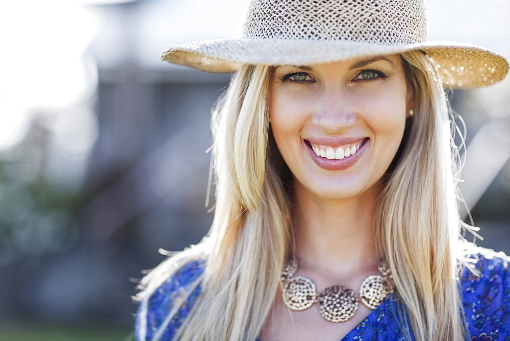 Portrait of smiling woman in straw hat