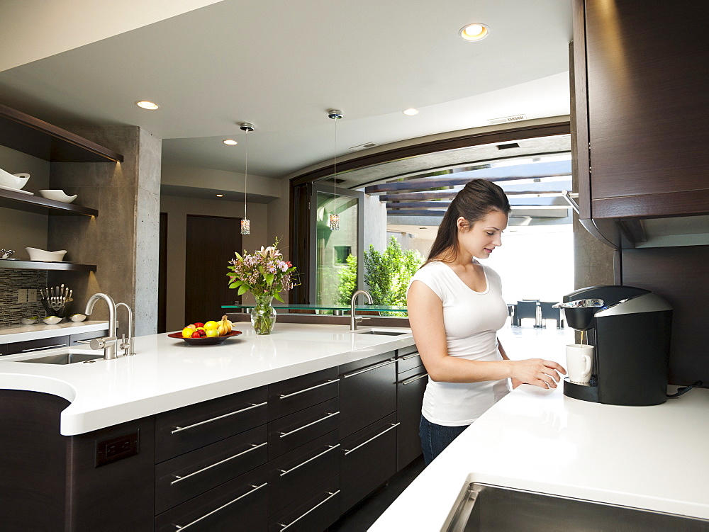 Young woman making morning coffee