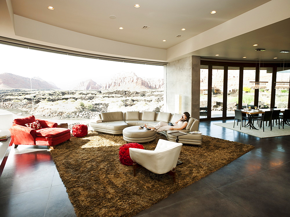 Young woman relaxing in her living room, USA, Utah, St. George