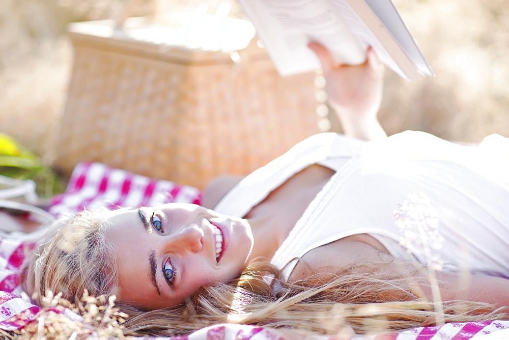 Happy teenage girl (16-17) relaxing outdoors
