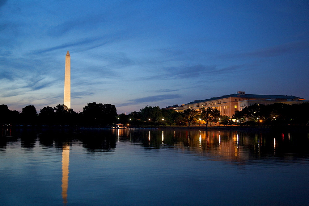 USA, Washington DC, Washington Monument reflecting in water at dusk