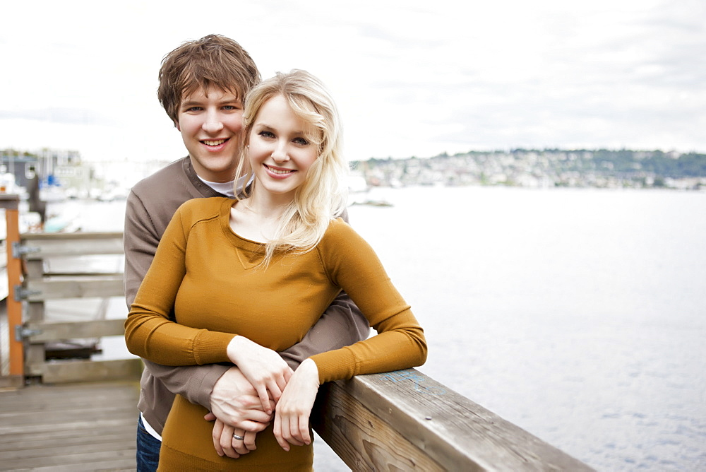 USA, Washington, Seattle, Portrait of young couple on pier