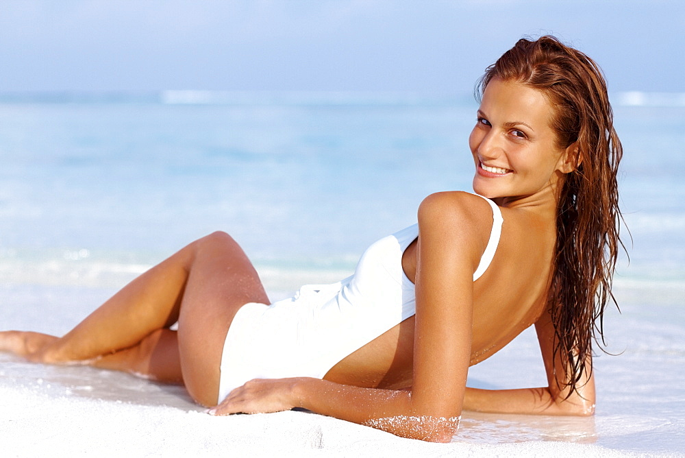 Portrait of attractive young woman relaxing on beach