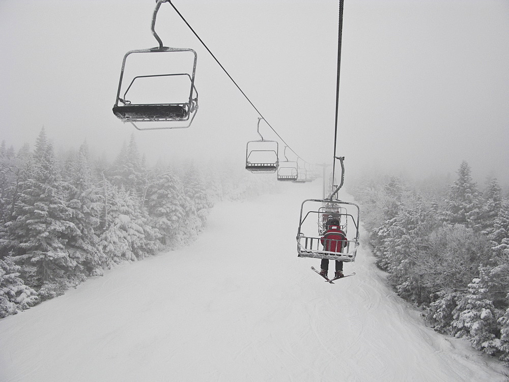 Skier on chair lift