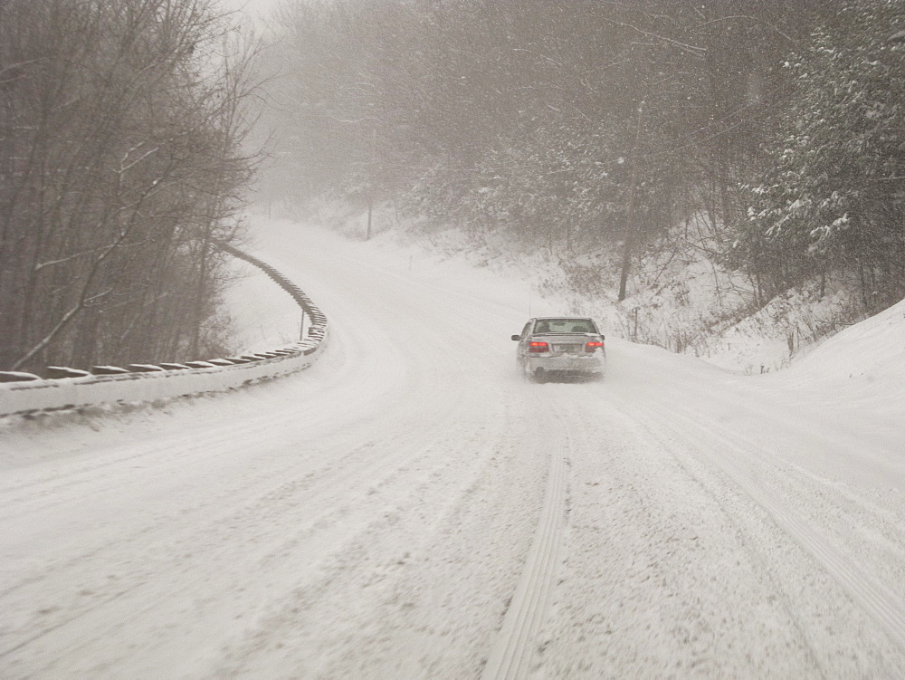 Car on country road in blizzard