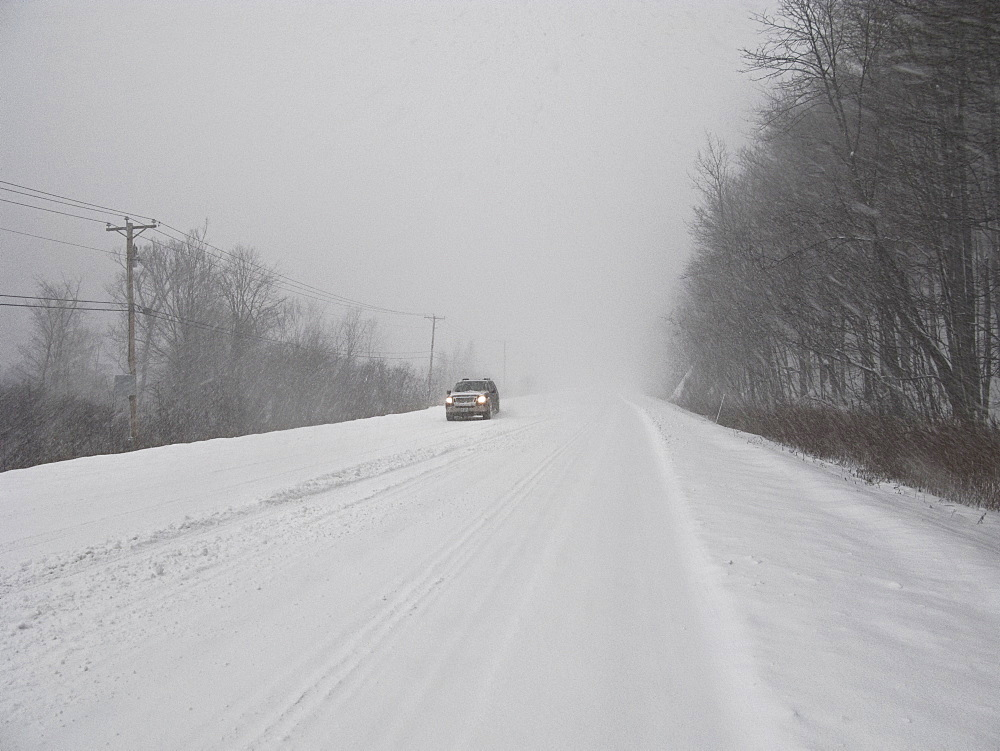 Car on road in blizzard