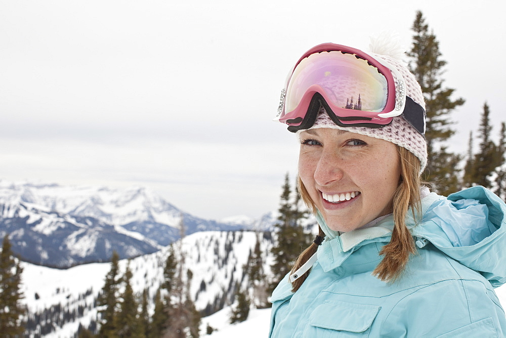 Portrait of female skier in mountains
