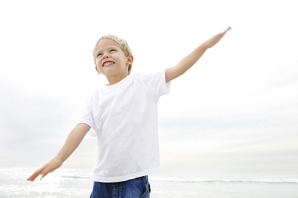 Boy (4-5) playing on beach