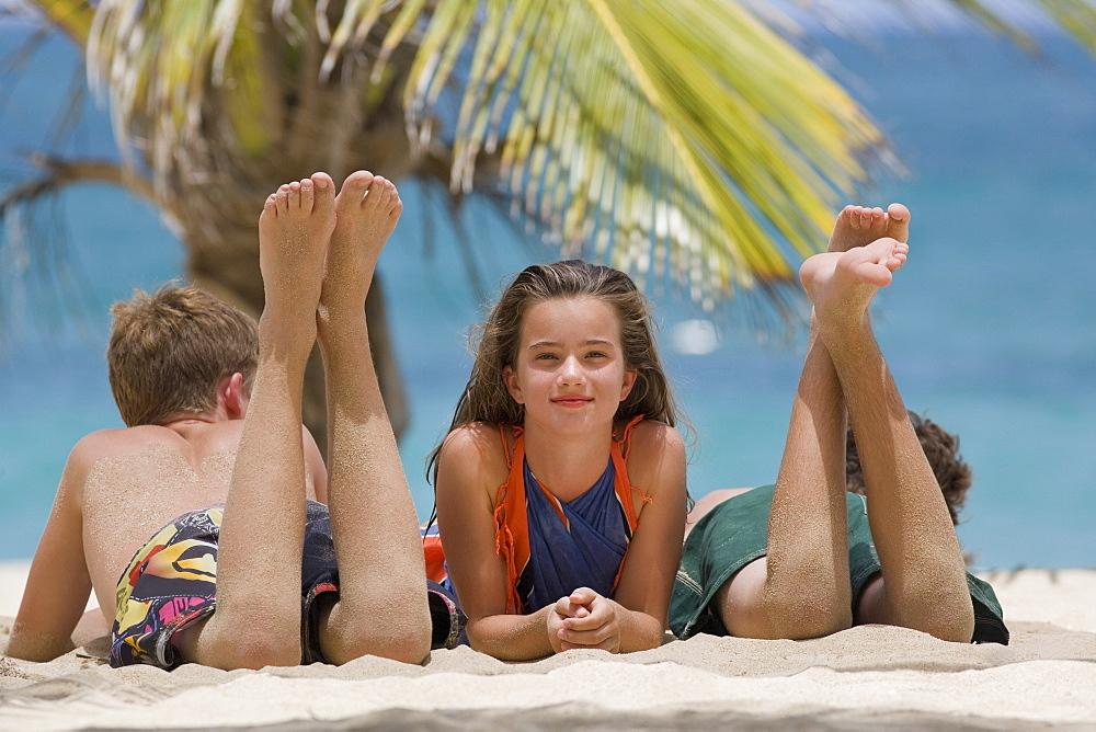 Children relaxing on beach