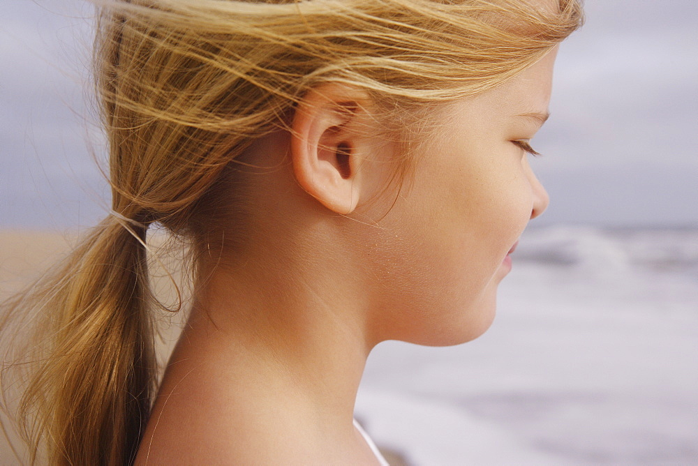 Profile of girl at beach