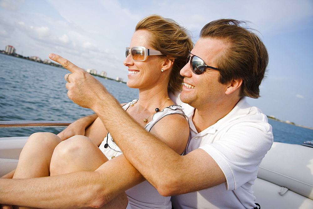 Couple pointing on boat