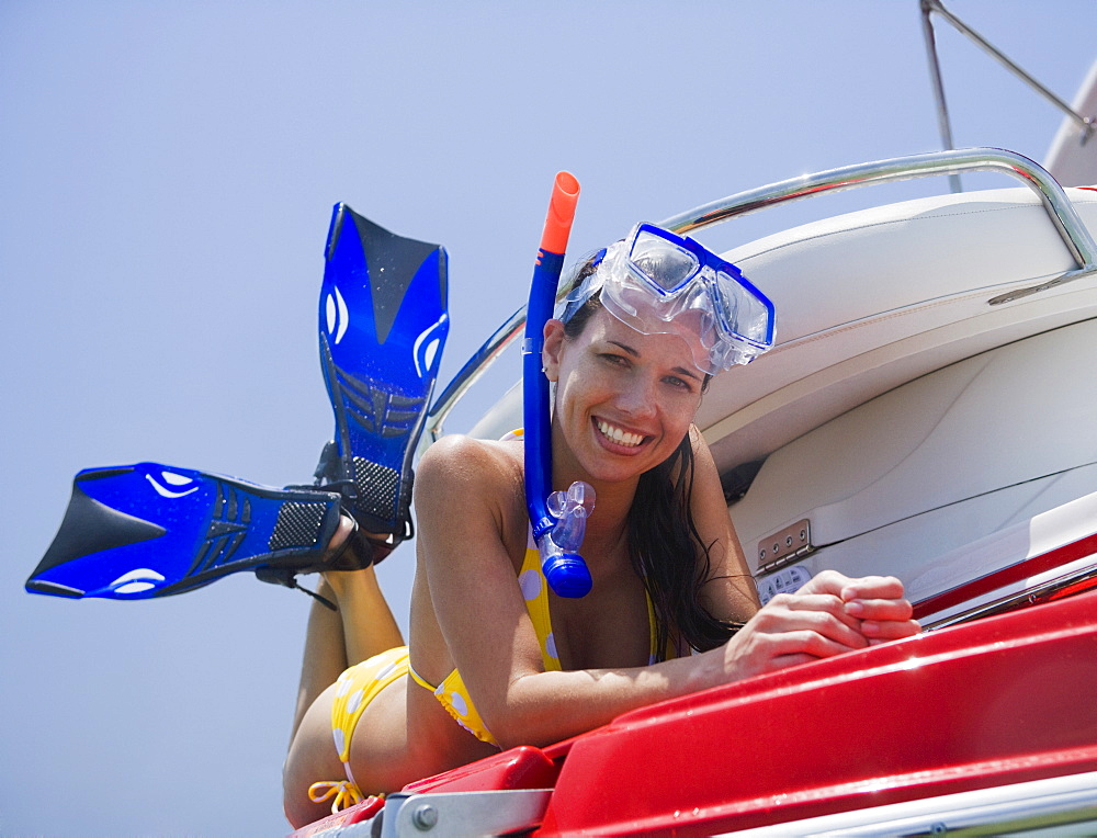 Woman in snorkeling gear on boat, Florida, United States