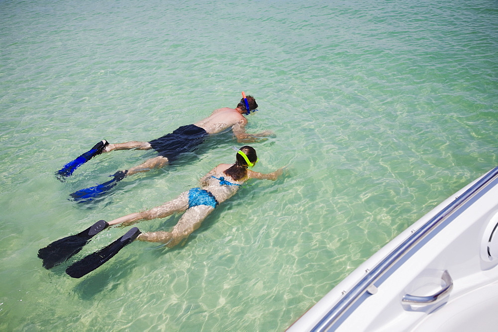 Father and daughter snorkeling in water, Florida, United States