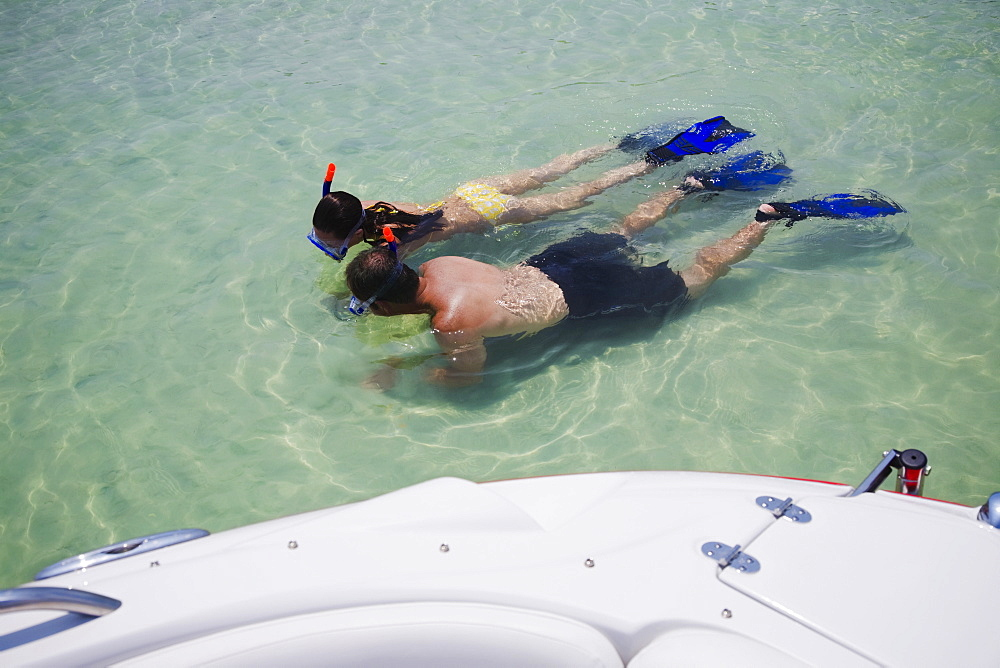 Couple snorkeling in water, Florida, United States