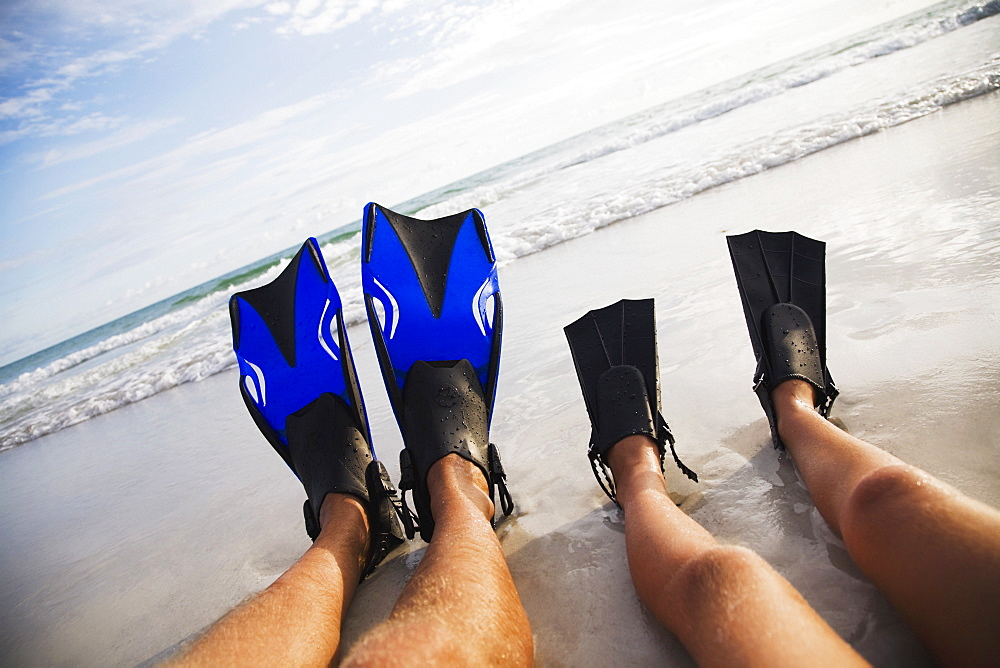 Father and child wearing flippers, Florida, United States