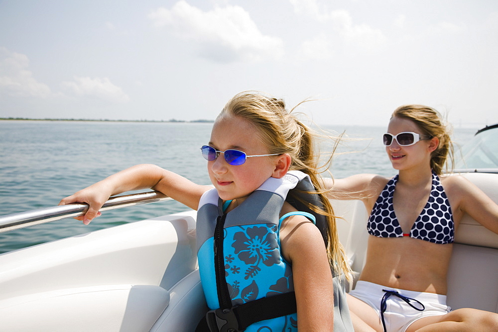 Sisters sitting on boat, Florida, United States