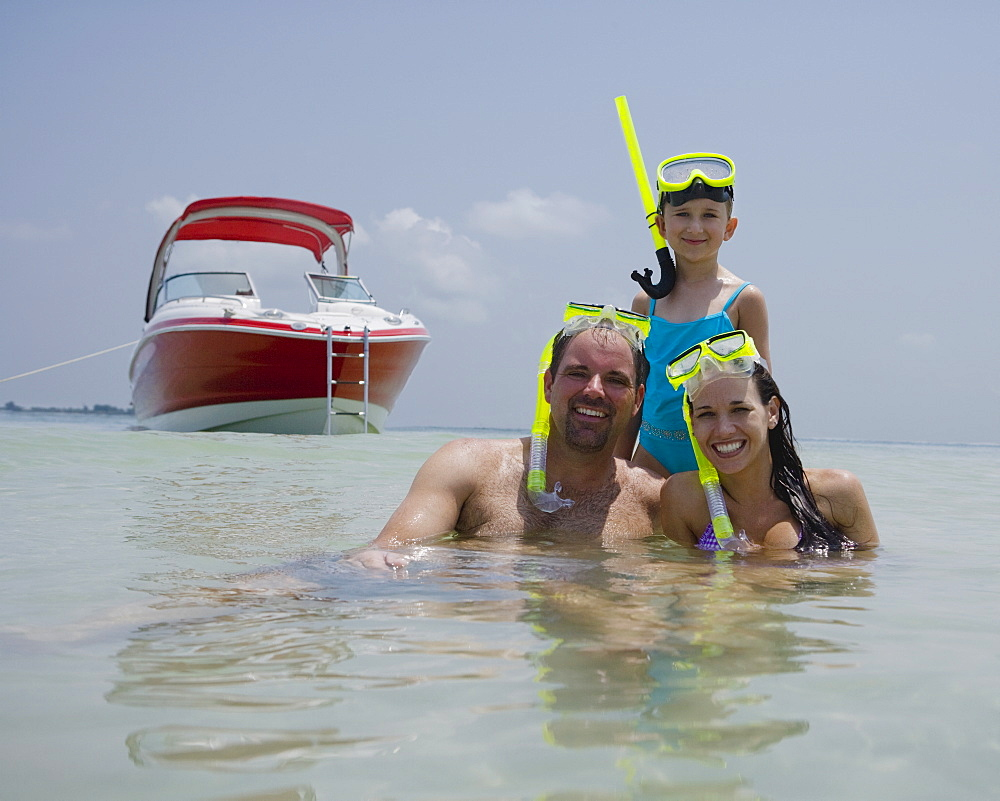 Family with snorkeling gear in water, Florida, United States