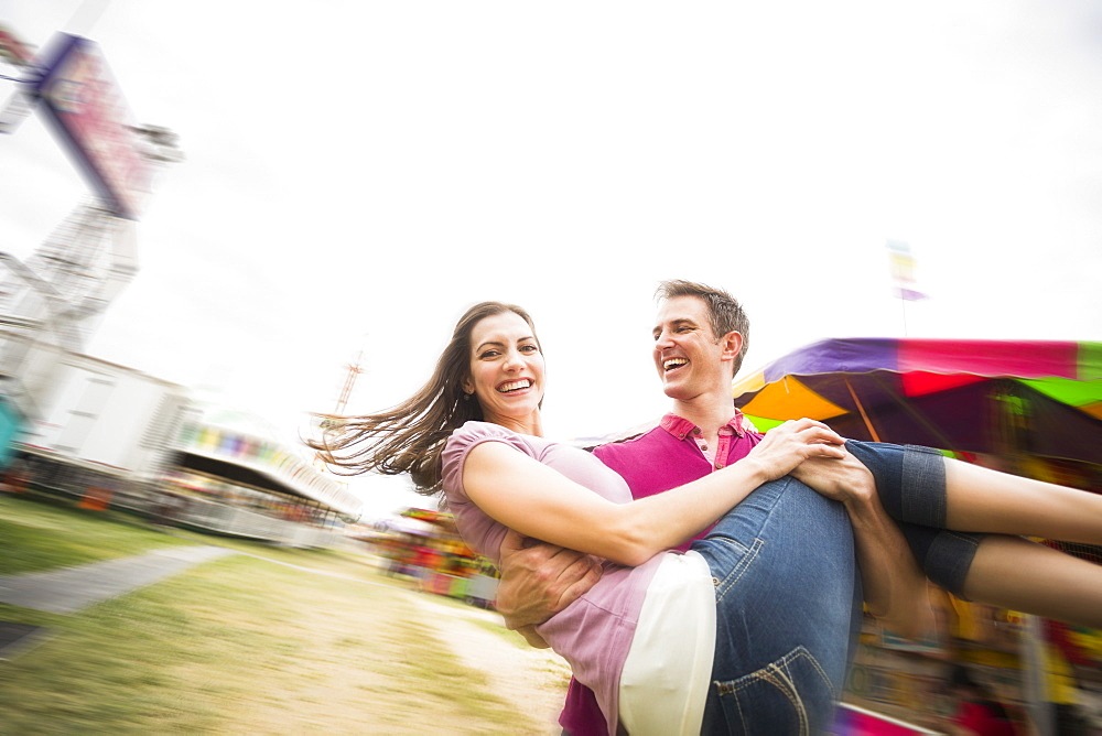 Couple in amusement park, USA, Utah, Salt Lake City