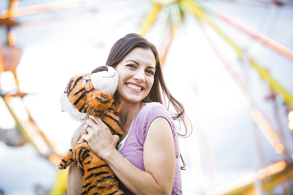 Portrait of woman with toy tiger, USA, Utah, Salt Lake City