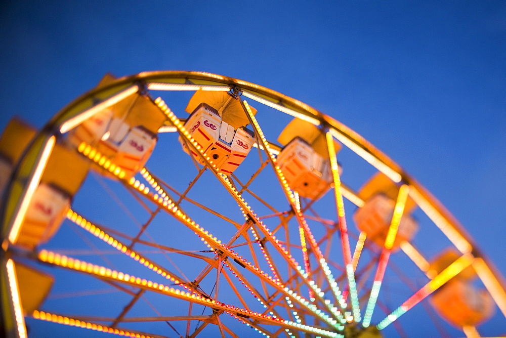 Ferris wheel in amusement park at dusk, USA, Utah, Salt Lake City