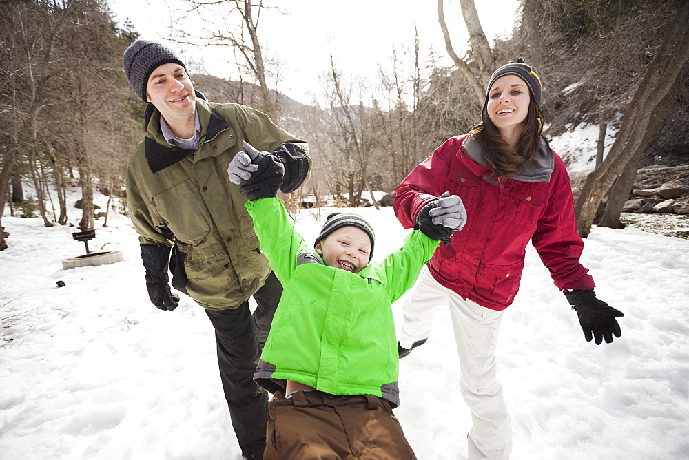 Front view of boy (4-5) with parents during stroll, USA, Utah, Highland