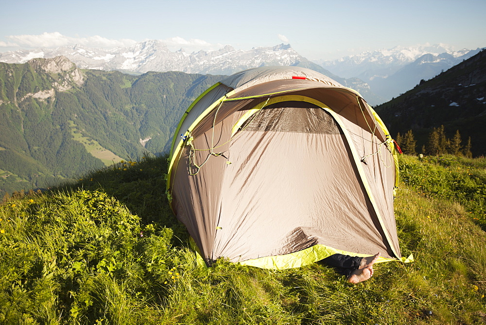 Switzerland, Leysin, Tent pitched on Alpine meadow, Switzerland, Leysin