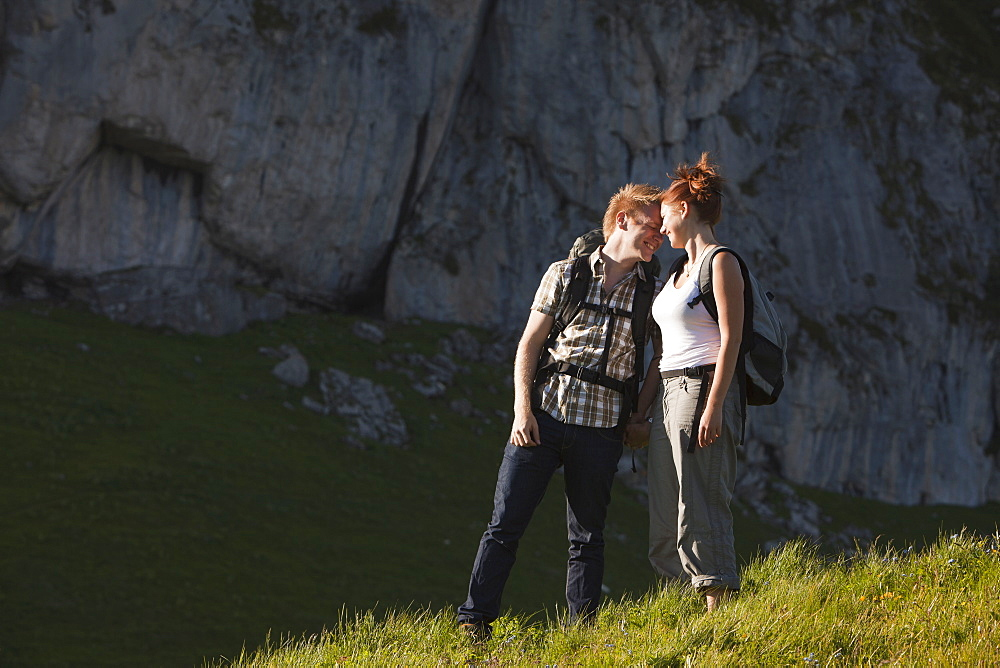 Switzerland, Leysin, Hikers on Alpine meadow, Switzerland, Leysin