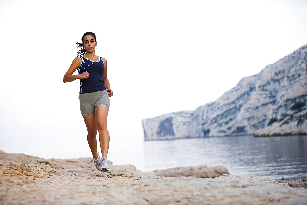 France, Marseille, Woman jogging by seaside, France, Marseille