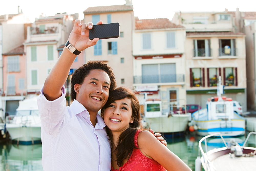 France, Cassis, Couple taking picture with smartphone, France, Cassis