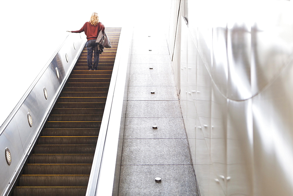 USA, California, Los Angeles, Woman on escalator in subway station