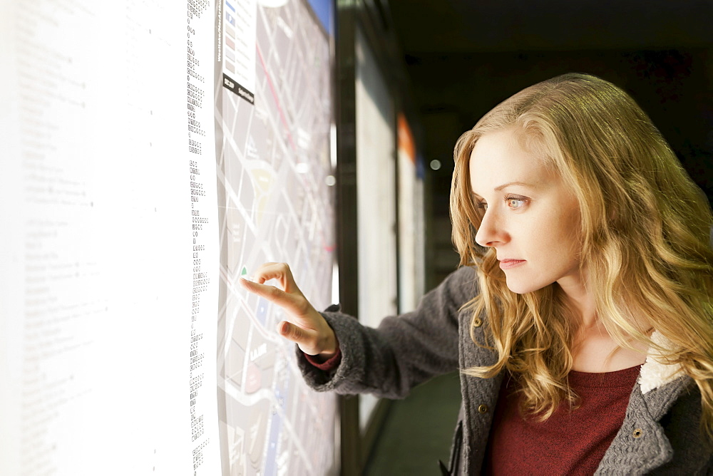 USA, California, Los Angeles, Woman at subway station checking map