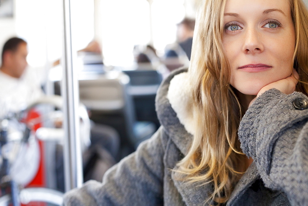 Portrait of woman in subway train
