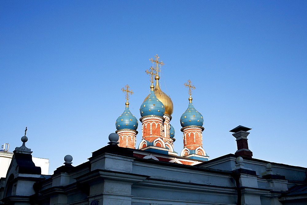 Russia, Moscow, Church domes against blue sky