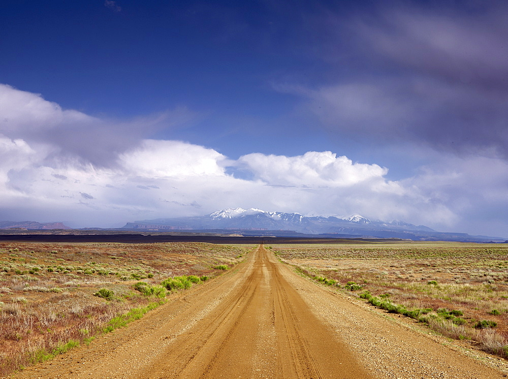 USA, Utah, Dirt road crossing landscape