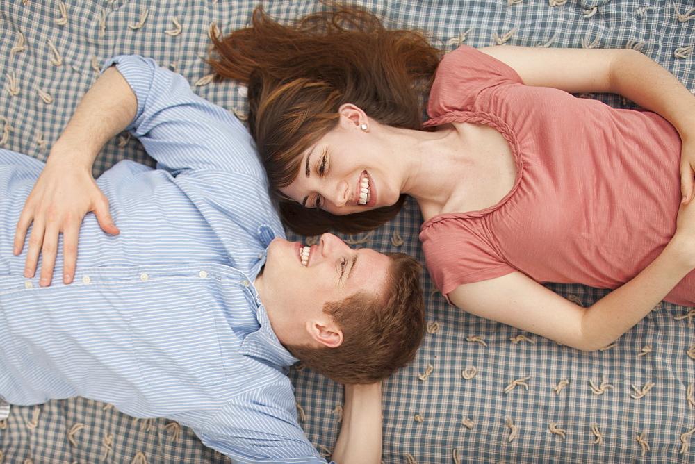 Young couple lying on blanket