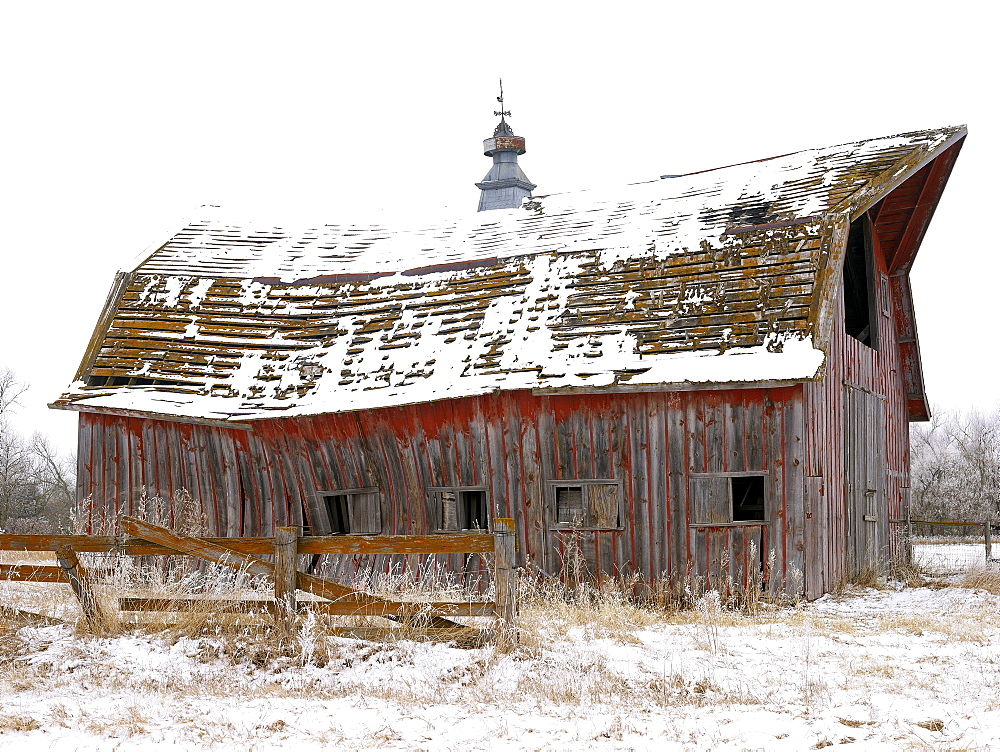 USA, New York State, Old wooden barn in snow