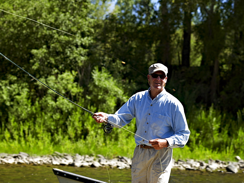 USA, Colorado, Man fly-fishing
