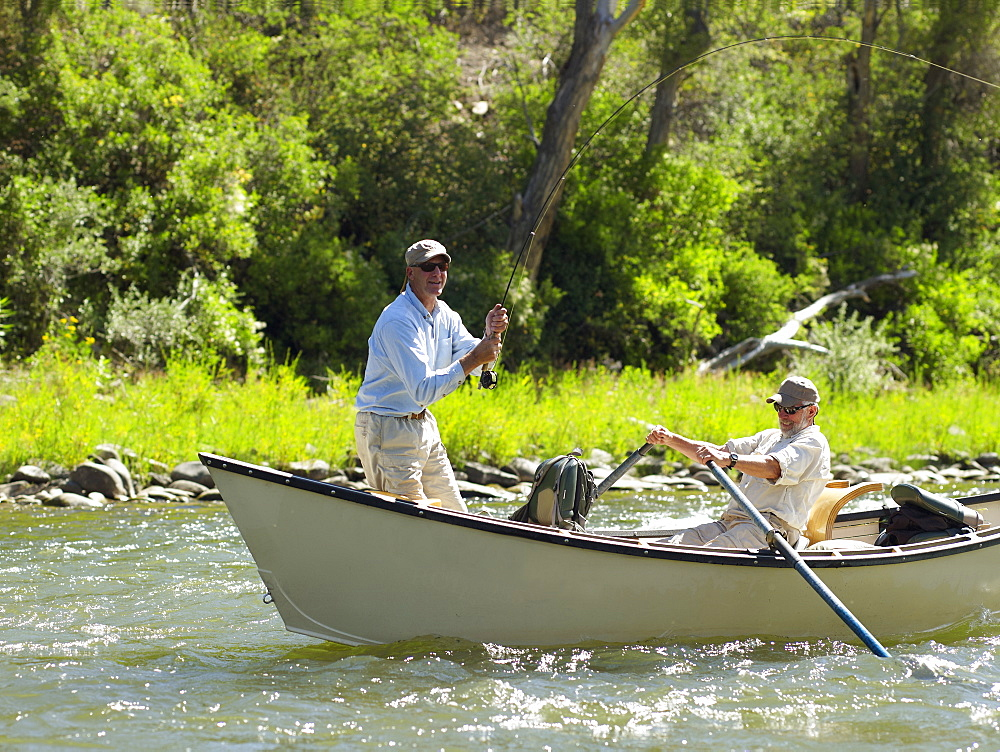 USA, Colorado, Pair of men fly-fishing