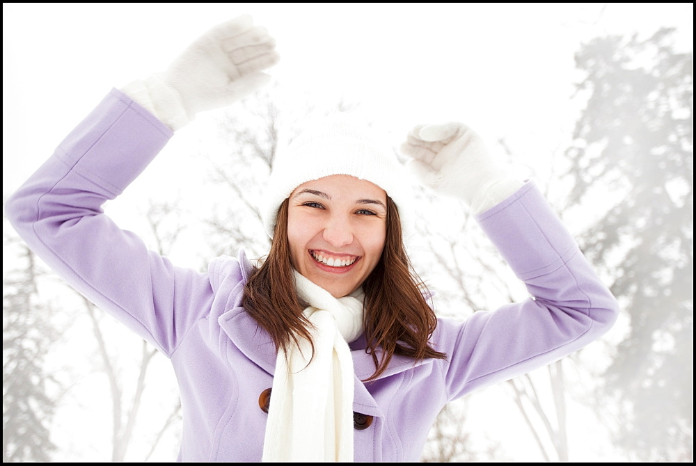 USA, Utah, Lehi, Portrait of young woman wearing winter coat outdoors