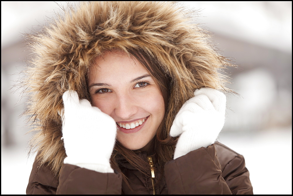 USA, Utah, Lehi, Portrait of young woman wearing fur hooded coat